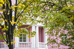 White balcony of pink house of classic style in autumn garden Stock Photography