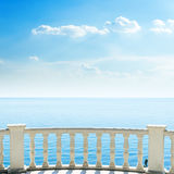 White balcony on sea beach and clouds Royalty Free Stock Images