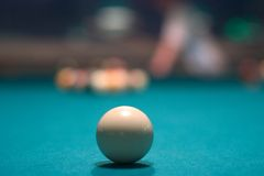 White Ball. White pool ball on pool table stock photography