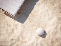 White ball on the beach sand. 3d rendering. Volleyball on the beach sand. 3d rendering Royalty Free Stock Image