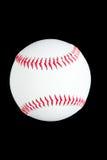 White ball on a black background. White leather baseball ball on black Stock Photography