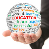 white ball in hand with red inscription education Stock Photography