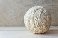 Free White Ball Of Yarn On A Wooden Table Over Vintage Wallpaper Stock Image - 37805961