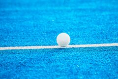White ball for playing field hockey. Blue filter