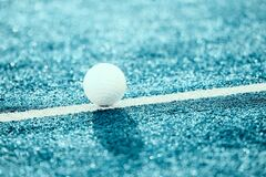 White ball for playing field hockey. Blue filter.