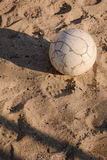 White ball on the sand. Ball lying on the sand in the summer Stock Photo
