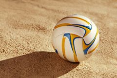 White ball on sand Royalty Free Stock Photos