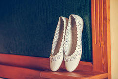 White ballet shoes. Bride with a bouquet in the hand is worth in the alley Stock Image
