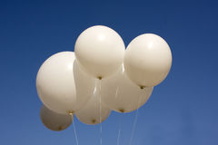White balloons. Into the sky blue Stock Image