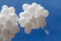 White balloons against the sky Royalty Free Stock Photo
