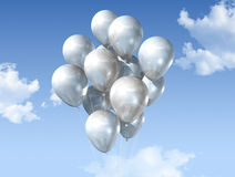 White balloons on a blue sky Royalty Free Stock Photography