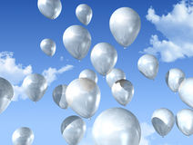 White balloons on a blue sky Royalty Free Stock Photos