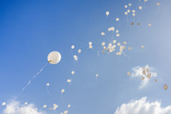 White balloons flying in the sky Royalty Free Stock Photos