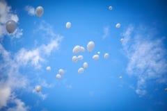 White Balloons on Sky Background Stock Photos