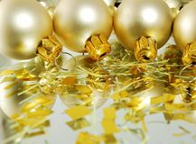 White balls. Christmas withe balls with bright gold decorations royalty free stock photography