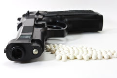 White balls with an black gun Stock Photography