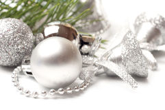 White balls and silver bell Stock Images