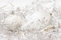 White balls and silver tinsel background Royalty Free Stock Photography