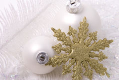 White balls and snowflake. New-year toys white balls and golden snowflake Royalty Free Stock Image