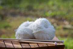 White balls of woll on a wooden chair. In autumn Royalty Free Stock Photo