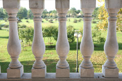 White balustrade. White stone balustrade in green garden Stock Photo