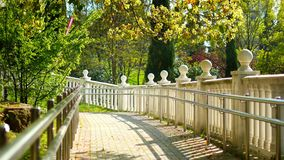 White balustrade with decorations from balls in a tropical park stock footage