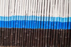 White bamboo. It is a bamboo fence painted white Stock Image