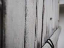 White bamboo wall side view. Bamboo background. royalty free stock photography