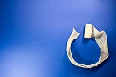 White bandage wraped in circle shape on a blue background Stock Photo