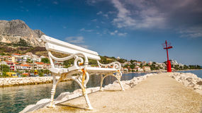 White bank on a mediterranean wharf Royalty Free Stock Photo