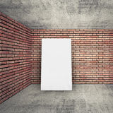 White banner, brick walls and concrete floor Royalty Free Stock Image