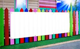 The white banner on the wooden fence color Stock Photo