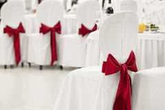 White banquet chair with a red bow. In the banquet hall Royalty Free Stock Photo