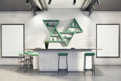 White bar interior, stand, posters. Modern bar interior with white brick walls, a concrete floor, a bar stand, two framed posters and triangular shelves, two Royalty Free Stock Image