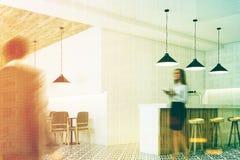 White bar interior, stools, corner, people Royalty Free Stock Images