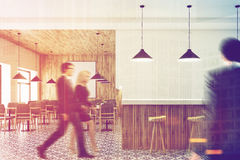 White bar interior, stools, poster, people Stock Photography