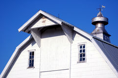 White barn. A close-up of a white barn with a weather vane in rural Warren County, Iowa Stock Photography