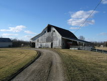 White barn. Old white barn on a farm Royalty Free Stock Photography