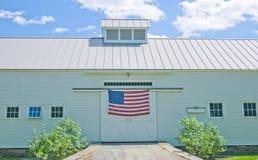 White Barn with American Flag. Impressive white barn with American Flag hanging on the front. Woodstock, Vermont royalty free stock photos