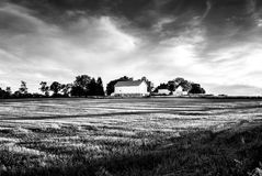 White barn at distance with field in foreground & x28;B&W& x29; Stock Photos