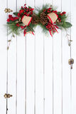 White barn door with rustic Christmas decoration Stock Images