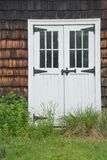 White barn doors and cedar shingles Royalty Free Stock Photo