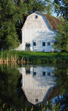 White barn on a farm in the country Royalty Free Stock Photo