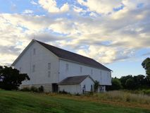 White Barn in Hershey Pennsylvania. Old white barn in Hershey, Pennsylvania on Bullfrog Valley Road with a pretty blue sky Royalty Free Stock Image