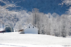 White Barn in the Snow Stock Images