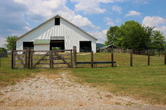 White Barn with Wood and Wire Fence Stock Image