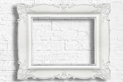 White baroque frame. On modern brick wall Stock Images