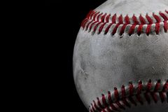 White baseball. Closeup of used white baseball with black background and copy space Stock Photos