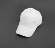 White baseball cap on gray background. Royalty Free Stock Photography