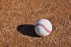 White Baseball on the Infield Royalty Free Stock Images